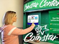 Coinstar Earnings Plunge on Fee Hikes